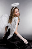 Pretty angel turning to you Stock Photography