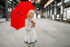 Pretty anime style blonde girl with red umbrella royalty free stock photos