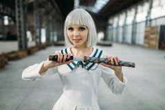 Pretty anime style blonde lady with sword stock photography