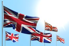 Pretty 5 flags of United Kingdom UK are waving on blue sky background - any feast flag 3d illustration stock illustration