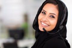 Arabian call center operator. Pretty Arabian call center operator closeup portrait Royalty Free Stock Photos