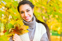 Pretty armenian girl in autumn park Stock Photography