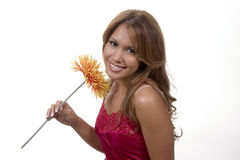 Pretty as a flower. Beautiful brunette model in studio holding a flower Royalty Free Stock Images