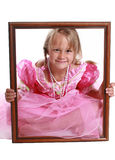 Pretty as a picture. A girl in a picture frame Royalty Free Stock Image