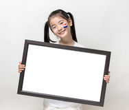 Pretty Asia little girl and white banner. Stock Photography