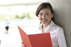 Pretty Asian Business woman holding a folder Stock Images
