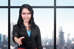 Pretty asian business woman offering a handshake for partnership Stock Image