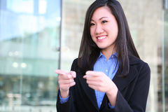 Pretty Asian Business Woman Pointing Stock Images