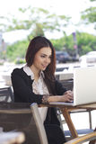 A pretty asian business woman using laptop outdoor Stock Photo
