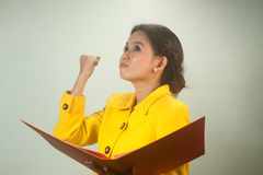 Pretty Asian businesswoman complacent reading a file. Royalty Free Stock Image