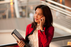 Pretty Asian businesswoman phone outside office. royalty free stock photo
