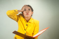 Pretty Asian businesswoman shocked and surprised. Stock Photos