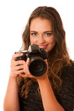 Pretty asian caucasian woman with camera in her hands Royalty Free Stock Photo