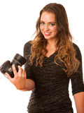 Pretty asian caucasian woman with camera in her hands Royalty Free Stock Images