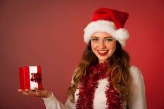 Pretty asian caucasian woman with santa claus hat celebrating ch Stock Photo