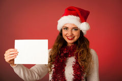 Pretty asian caucasian woman with santa claus hat celebrating ch Royalty Free Stock Image