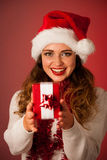 Pretty asian caucasian woman with santa claus hat celebrating ch Royalty Free Stock Photos