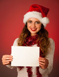 Pretty asian caucasian woman with santa claus hat celebrating ch Stock Photos