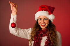 Pretty asian caucasian woman with santa claus hat celebrating ch Royalty Free Stock Photography