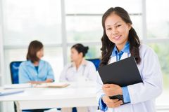 Pretty asian doctor. Asian female doctor standing and smiling Stock Photography