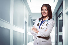 Pretty asian doctor smiling with hospital background Royalty Free Stock Image