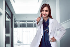 Pretty asian doctor smiling with hospital background Royalty Free Stock Images