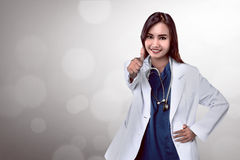 Pretty asian doctor smiling with hospital background Stock Photography