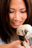 Pretty asian female holding  puppy Stock Photo
