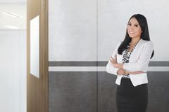 Pretty asian female teacher standing. On the classroom royalty free stock images