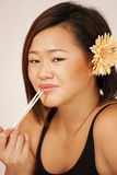 Pretty asian girl with chopsticks Stock Photography