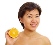 Pretty asian girl with half orange Stock Image