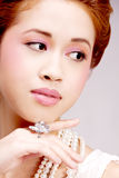 Pretty asian girl with luxury jewelery and soft makeup Royalty Free Stock Image