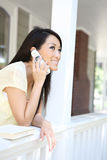 Pretty Asian Girl on Phone at Home Stock Images