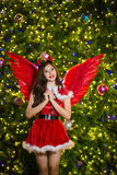 Pretty Asian girl in Santa costume for Christmas with night ligh Stock Image