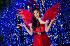 Pretty Asian girl in Santa costume for Christmas with night ligh Stock Photography