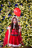 Pretty Asian girl in Santa costume for Christmas with night ligh Royalty Free Stock Photography