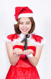 Pretty Asian girl in Santa costume for Christmas on white backgr Royalty Free Stock Image