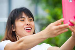 Pretty Asian girl taking a selfie Stock Photo