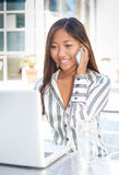 Pretty asian girl talking on cell phone Stock Photography