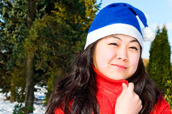 Pretty asian girl in winter park Stock Photo