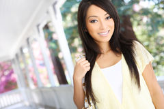 Pretty Asian  at home on Porch Stock Photo