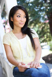 Pretty Asian at home on Porch Royalty Free Stock Images