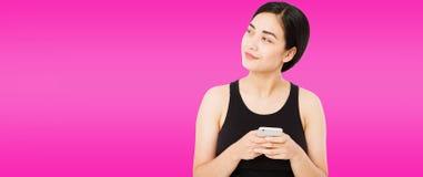 Pretty asian,korean woman on purple background, girl hold phone.  stock photos
