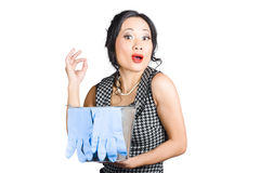 Pretty asian lady giving ok gesture to clean Royalty Free Stock Image