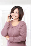 Pretty Asian middle aged Woman on the phone Royalty Free Stock Images