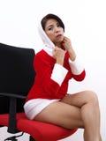 Pretty Asian model wearing Christmas uniform Royalty Free Stock Photos