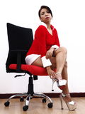 Pretty Asian Mother Christmas wearing sexy shoes Stock Photography