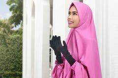 Pretty asian muslim woman with headscarf pray to god Stock Photography
