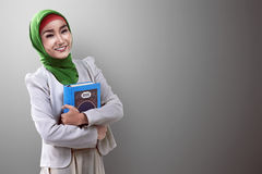 Pretty asian muslim woman holding koran Royalty Free Stock Photo