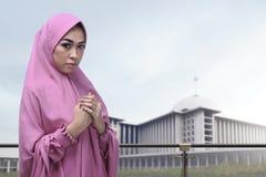 Pretty asian muslim woman in veil praying Stock Images